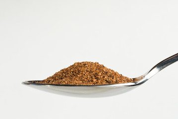 Ground Nutmeg on a Spoon