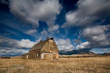 Old barn against backdrop of Bridger Mountains, Bozeman, Montana