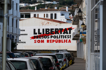 Political graffiti, in the Catalan language, stenciled onto the ground. calling for freedom for political prisoners. in the town of Figueres.