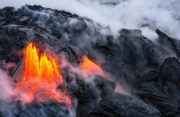 Lava from the Pu'u'o'o vent of the Kilauea volcano entering the ocean near Kalapana, Hawaii.