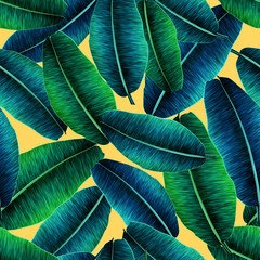 Tropical banana leaves, jungle leaf seamless floral pattern yellow background. Artistic palms pattern with seamless repeating design. Pattern for summer designs.