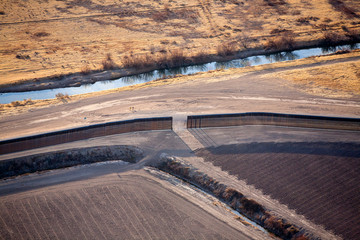 Near El Paso, Texas: Aerial view of the US/Mexico border and border fence.
