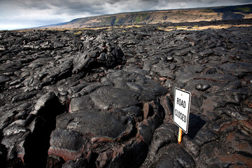 VOLCANOES NATIONAL PARK, HAWAII: A road closed from lava flow.