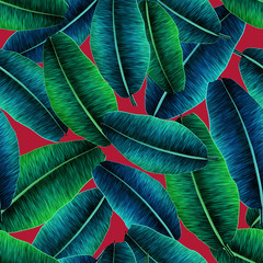 Tropical banana leaves, jungle leaf seamless floral pattern red background. Artistic palms pattern with seamless repeating design. Pattern for summer designs.