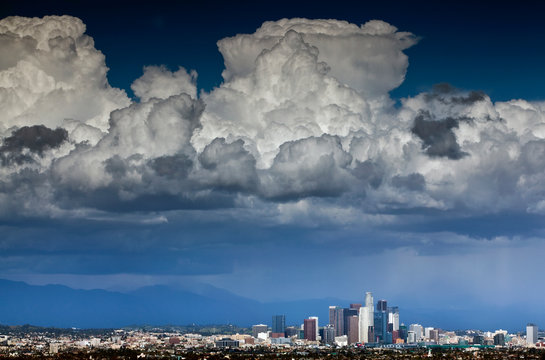 Downtown Los Angeles, California with cumulonimbus clouds forming overhead.