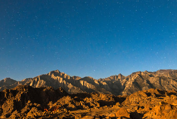 Mt. Whitney and the Alabama Hills at moon rise, near Lone Pine CA in Owens Valley.