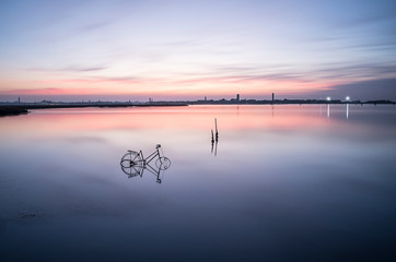 peace and tranquility in the Venice lagoon. A long exposure with the soft colors of the summer sunset.