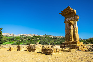 Ruins of Temple of Castor and Pollux with Agrigento in the Background.