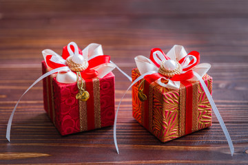 Two red gift boxes on wooden background