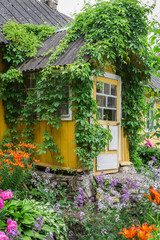 Beautiful vintage cottage with colorful landscaping