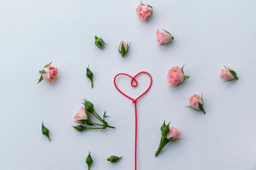 Greeting card for Valentine's Day, rosebuds, heart, love, background.