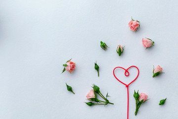 Greeting card for Valentine's Day, rosebuds, heart, love, background. Place for text.