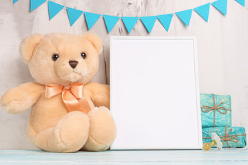 Baby toys and frame on light wall background, for design. Baby shower