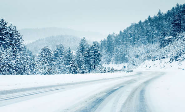 Mountain road landscape covered in snow in winter