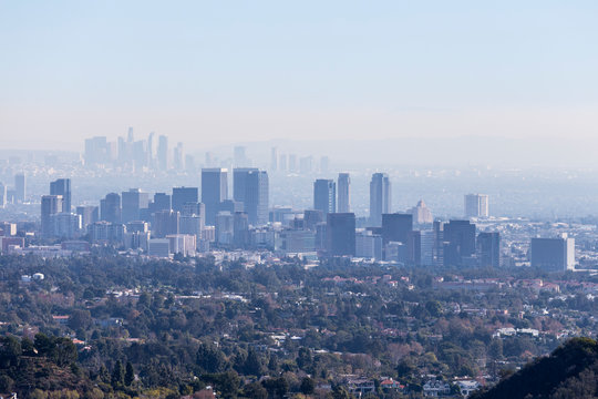 Smoggy morning cityscape view towards Century City and downtown Los Angeles from hiking trail in the Santa Monica Mountains.