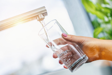 water; tap; glass; drink; kitchen; filling; sink; woman; faucet; lifestyle; hand; clean; home; aqua; beverage; bubbles; clear; nails; cool; cup; finger; fitting; beauty; flowing; fresh; full; health;