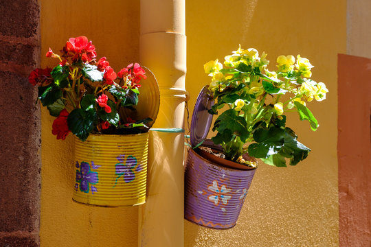 Traditional flower cans in Village of Bosa, Sardinia, Italy.