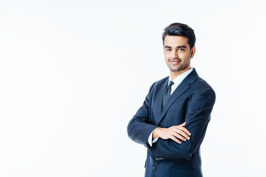 Portrait of a confident smiling businessman with arms crossed