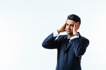 Portrait of a cool businessman  holding his head in disbelief or in pain, isolated on white background.