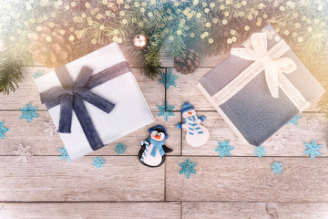 Christmas gift boxes and decoration on wooden table, directly above.