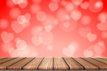 Empty Wooden board top table in front of blurred red heart background. Perspective wood in blurred bokeh heart valentine day background for photo montage, product display or mock up your product.