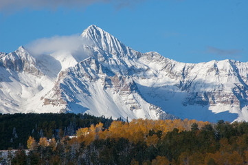 Mountain peak with fall colors and snow