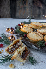 Christmas mince mini pies in festive setting flat lay