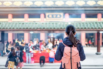 Young woman traveling bacpacker, Asian traveler visit the Che Kung Temple, landmark and popular for tourist attractions in Hong Kong