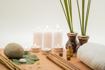 Spa concept, composition with bamboo, stones, leaves and candles