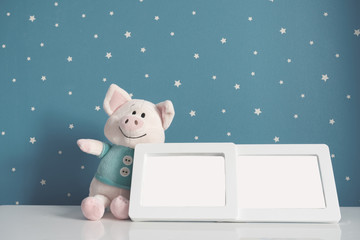 picture frame and piggy toy in baby room