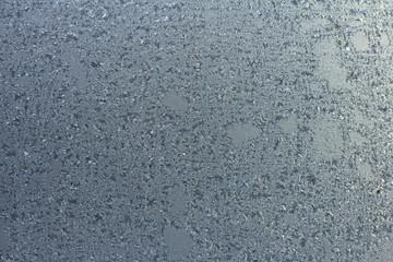 Frozen window texture with gradient. Selective focus.