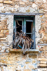 Window in an Abandoned House in a Village in Southern Italy