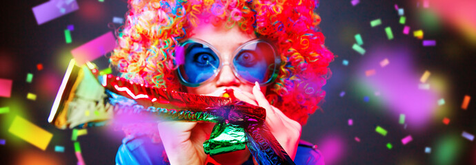 Portrait of beautiful party woman in wig and glasses Carneval.