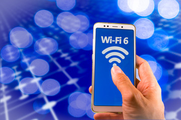 Smartphone with new wifi 6 on the screen. Wi-fi 6 is the next generation Wi-fi connectivity with high capacity, coverage and performance.