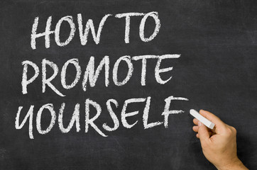 How to promote yourself written on a blackboard