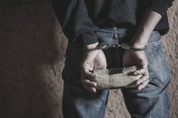 Police arrest drug trafficker with handcuffs. Law and police concept.  World Anti-drug Day