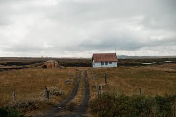 country house and amazing Nordic landscape, Iceland. Travel and nature.