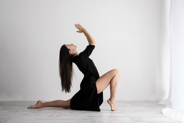 Sporty young woman doing yoga practice on white background - concept of healthy life and natural balance between body and mental development.