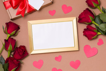 Valentines day,empty frame,nude background, gift,red roses,hearts,message,free copy text space