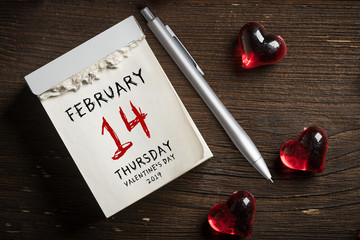 tear-off calendar with Valentine's Day 2019 on top