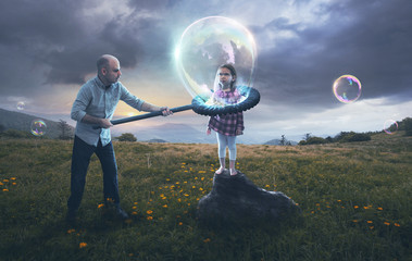 Father putting child in a bubble