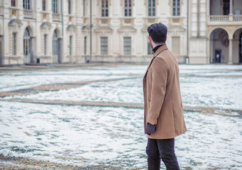 Handsome trendy man wearing elagant jacket, outdoor in city setting in winter day shot