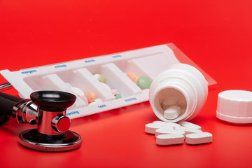 Blister tablets, red background