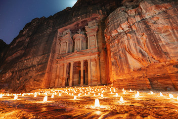 Petra by night, Treasury ancient architecture in canyon, Petra in Jordan. 7 wonders travel destination in Jordan Fototapete