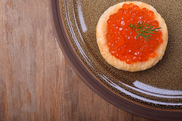 Close-up of red caviar in a tartlet
