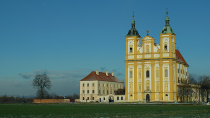 Pilgrimage church Ocistovani Panny Marie in winter tree, in the Dub nad Moravou, a baroque church in a field in the agricultural landscape, blue sky, Central Moravia, Czech Republic, Europe