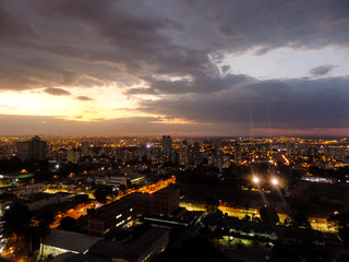 Golden hour, magic hour in a building and night lights in Goiânia, Goiás, Brazil