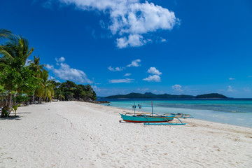 Printed kitchen splashbacks Zanzibar Tropical background view from Malcapuya island with traditional philippines boat and white sand beach. Travel vacation at Philippines.