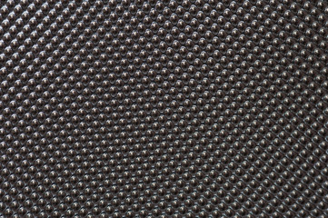 Plastic metalic dot pattern in grey colour. Abstract background of lots of grey pimples dots.