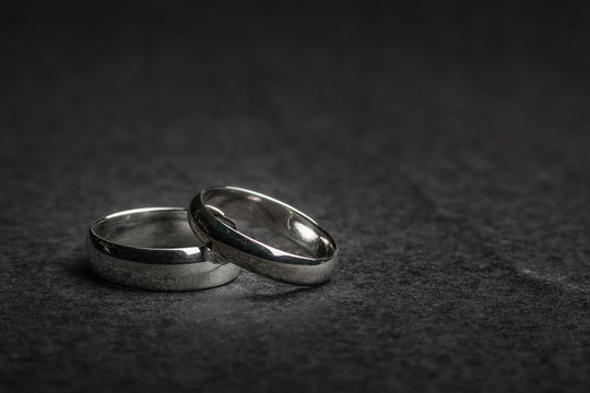 Silver Wedding Rings on a rock background